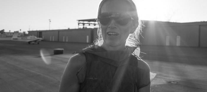Andrea Lenardin madden at an airport hangar